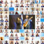 """""""Noin 150 henkilön kasvokuvasta koottu kollaasi, jonka keskellä isompi yhteiskuva Jukka Kuppamäestä kitaroineen ja tyttärestään."""""""